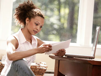 woman-opening-mail-direct mail